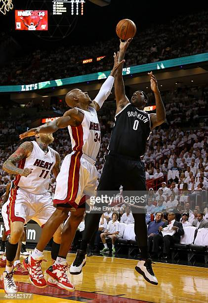 Andray Blatche of the Brooklyn Nets shoots over Ray Allen of the Miami Heat during Game One of the Eastern Conference Semifinals of the 2014 NBA...