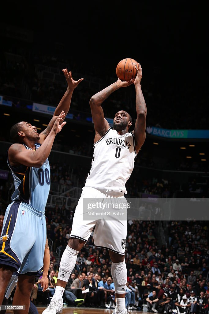 Andray Blatche #0 of the Brooklyn Nets shoots the ball against Darrell Arthur #00 of the Memphis Grizzlies on February 24, 2013 at the Barclays Center in the Brooklyn borough of New York City.