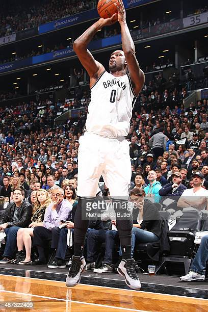 Andray Blatche of the Brooklyn Nets shoots the ball against the Toronto Raptors during Game Four of the Eastern Conference Quarterfinals at Barclays...
