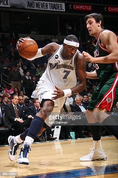 Andray Blatche of the Washington Wizards drives against Andrew Bogut of the Milwaukee Bucks during the game on March 5 2010 at the Verizon Center in...