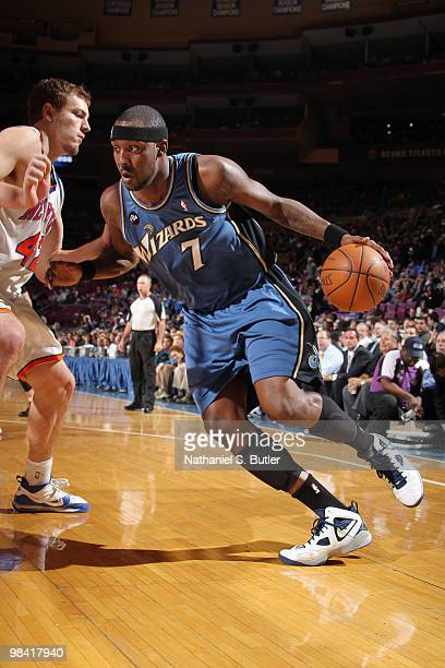 Andray Blatche of the Washington Wizards drives against David Lee of the New York Knicks on April 12 2010 at Madison Square Garden in New York City...