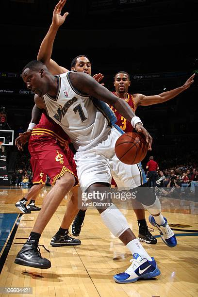 Andray Blatche of the Washington Wizards drives against Ryan Hollins of the Cleveland Cavaliers at the Verizon Center on November 6 2010 in...