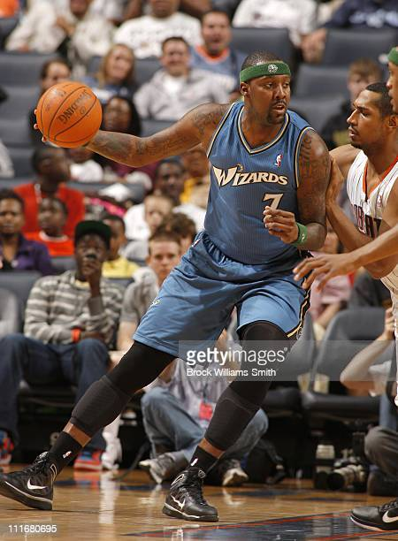 Andray Blatche of the Washington Wizards shoots the ball during a game against the Charlotte Bobcats on April 3 2011 at Time Warner Cable Arena in...