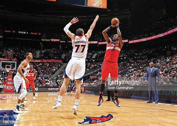 Andray Blatche of the Washington Wizards shoots the basketball against Vladimir Radmanovic of the Atlanta Hawks on December 28 2011 at Philips Arena...