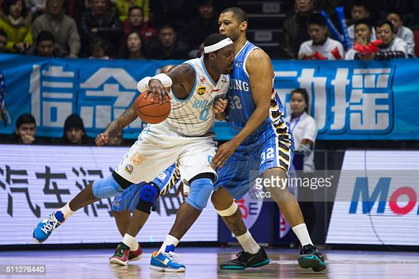 Andray Blatche of Xinjiang Flying Tigers drives the ball against Randolph Morris of Beijing Ducks during the Chinese Basketball Association 15/16...