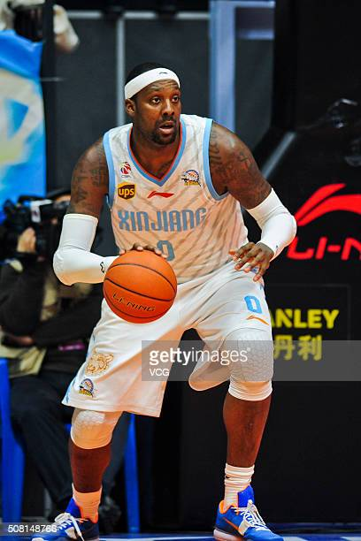 Andray Blatche of Xinjiang Flying Tigers drives the ball during the 37th round of the Chinese Basketball Association 15/16 game between Xinjiang...