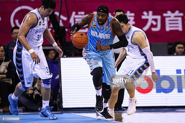 Andray Blatche of Xinjiang Flying Tigers drives the ball during the Chinese Basketball Association 15/16 season playoff quarterfinal match between...