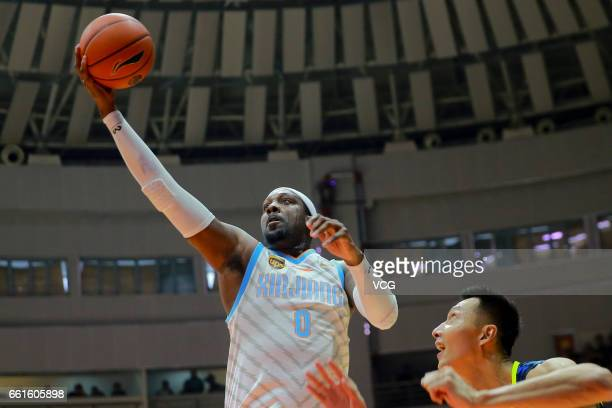 Andray Blatche of Xinjiang Flying Tigers shoots the ball against Yi Jianlian of Guangdong Southern Tigers in Game One of the 2017 CBA Finals at...