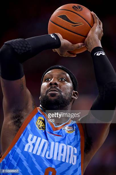 Andray Blatche of Xinjiang Flying Tigers shoots the ball during the Chinese Basketball Association 15/16 season playoff quarterfinal match between...