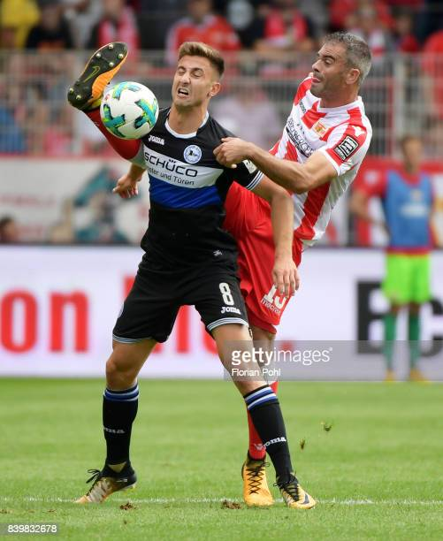 Andraz Sporar of Arminia Bielefeld and Marc Torrejon of 1 FC Union Berlin during the game between Union Berlin and Arminia Bilefeld on august 27 2017...