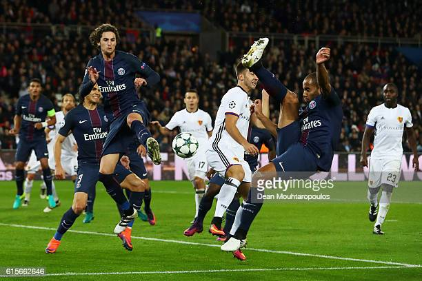 Andraz Sporar of Basel battles for the ball with p25 Edinson Cavani and Lucas Moura of PSG during the Group A UEFA Champions League match between...