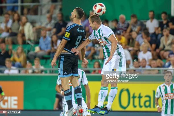 Andraz Sporar of Slovan Bratislava challenges Mario Sonnleitner of Rapid during the UEFA Europa League Third Round Qualifier Second Leg match between...