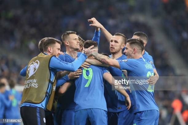 Andraz Sporar of Slovenia and Benjamin Verbic of Slovenia celebrate with team mates during the 2020 UEFA European Championships group G qualifying...