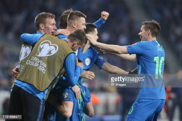 Andraz Sporar of Slovenia celebrates after scoring his team's first goal with team mates during the 2020 UEFA European Championships group G...