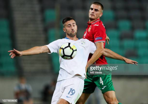 Andraz Sporar of Slovenia faulted by Bozhidar Chorbadzhiyski of Bulgaria during football match between National Teams of Slovenia and Bulgaria in...