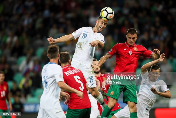 Andraz Sporar of Slovenia jumps for a ball during football match between National Teams of Slovenia and Bulgaria in Final Tournament of UEFA Nations...