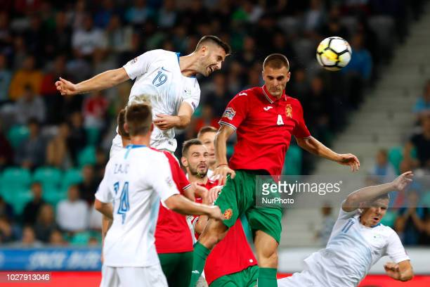 Andraz Sporar of Slovenia vs Bozhidar Chorbadzhyskii of Bulgaria during football match between National Teams of Slovenia and Bulgaria in Final...