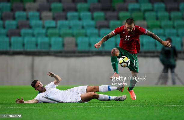 Andraz Sporar of Slovenia vs Ivan Bandalovski of Bulgaria during football match between National Teams of Slovenia and Bulgaria in Final Tournament...