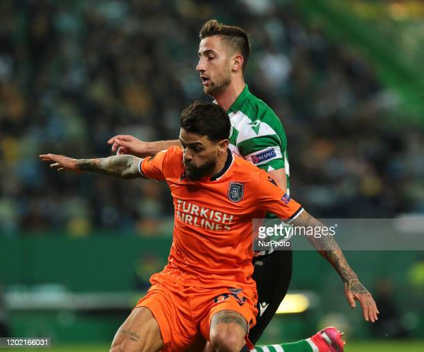 Andraz Sporar of Sporting CP and Júnior Caiçara of Istambul Basaksehir in action during the UEFA Europa League Round of 32 - First Leg match between...