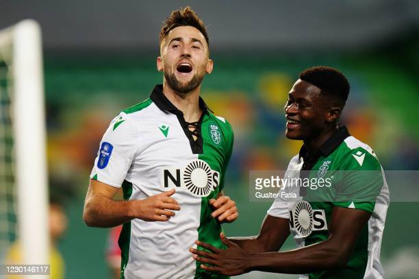 Andraz Sporar of Sporting CP celebrates with teammate Nuno Mendes of Sporting CP after scoring a goal during the Portuguese League Cup match between...