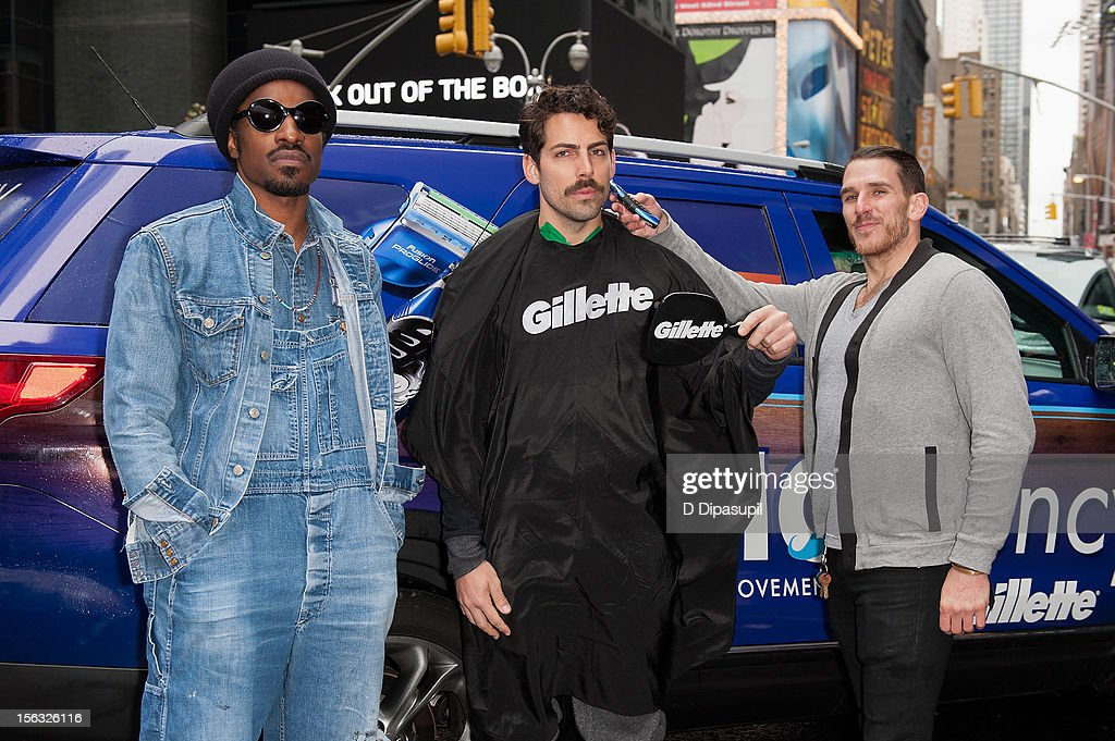 Andre 3000 (L) attends the Gillette 'Movember' Event in Times Square on November 13, 2012 in New York City.