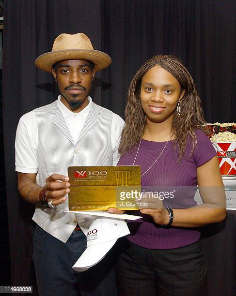 Andre 3000 with Jenise Richards of Loews Cineplex and the Loews Cineplex Entertainment Annual Movie Pass for 2 presented to Andre 3000