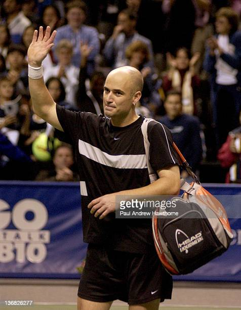 Andre Agassi acknowledges the fans after his loss to Mardy Fish at the 2004 Siebel Open in San Jose California February 14 2004 Fish upset Agassi to...