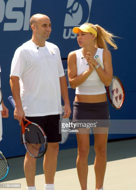 Andre Agassi and Anna Kournikova during 2003 US Open - Arthur Ashe Kids Day at USTA National Tennis Center in Queens, New York, United States.
