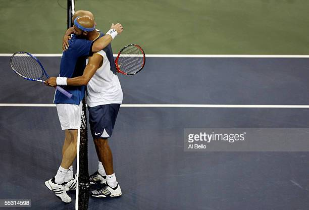 Andre Agassi and James Blake embrace after their quarterfinal match at the US Open at the USTA National Tennis Center in Flushing Meadows Corona Park...