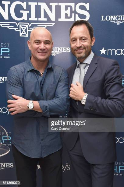 Andre Agassi and President of Longines United States Pascal Savoy attend the launch of Longines Master Collection Watch at Macy's Herald Square on...