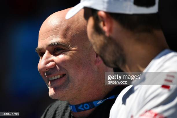 Andre Agassi and Radek Stepanek part of the coaching team of Serbia's Novak Djokovic watch during his men's singles first round match against Donald...