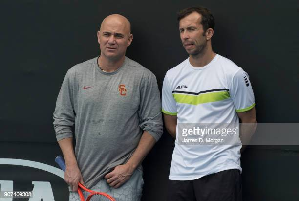 Andre Agassi and Radek Stepanek watch their player Novak Djokovic during practice on day six of the 2018 Australian Open at Melbourne Park on January...