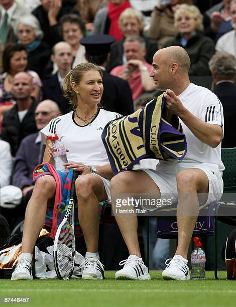 """Andre Agassi and Steffi Graf chat during the Mixed Doubles match against Tim Henman and Kim Clijsters during the """"Centre Court Celebration"""" at..."""