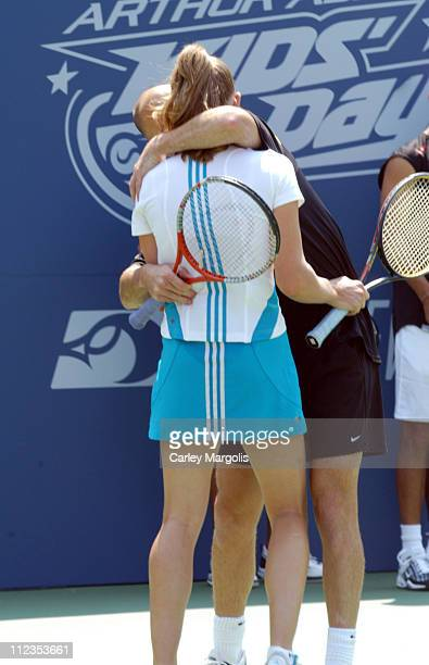 Andre Agassi and Steffi Graf during 2004 US Open Arthur Ashe Kids' Day at Arthur Ashe Tennis Stadium in New York City New York United States