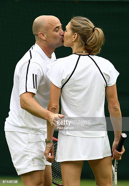 """Andre Agassi and Steffi Graf share a kiss during the Mixed Doubles match against Tim Henman and Kim Clijsters during the """"Centre Court Celebration""""..."""