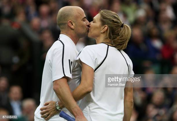 Andre Agassi and Steffi Graf share a kiss during the Mixed Doubles match against Tim Henman and Kim Clijsters during the 'Centre Court Celebration'...