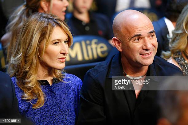 Andre Agassi and wife Steffi Graf watches the Leo Santa Cruz against Jose Cayetano featherweight bout on May 2 2015 at MGM Grand Garden Arena in Las...