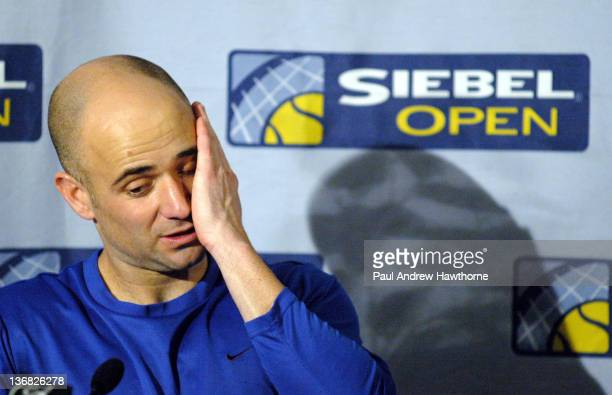 Andre Agassi answers questions after his match about his poor performance and behavior during his match with Mardy Fish at the 2004 Siebel Open in...