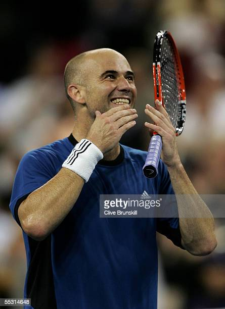 Andre Agassi blows kisses after defeating James Blake in the quarterfinals of the US Open at the USTA National Tennis Center in Flushing Meadows...