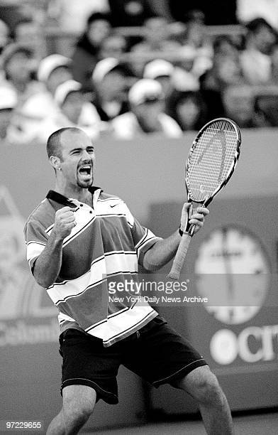 Andre Agassi celebrates a third set win against Pete Sampras in the US Open In the end Sampras won the match and the men's championship