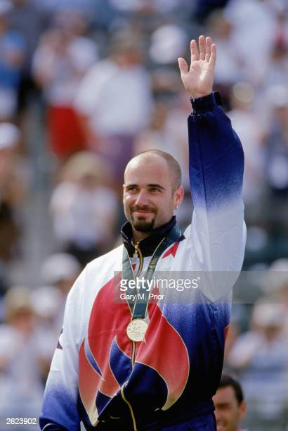 Andre Agassi celebrates as he stands as the men's tennis singles gold medal winner during the XXVI Olympic Games at the Stone Mountain Tennis Center...
