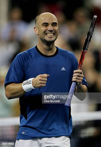 Andre Agassi celebrates defeating James Blake in the quarterfinals of the US Open at the USTA National Tennis Center in Flushing Meadows Corona Park...