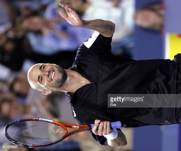 Andre Agassi celebrates his three set win over Andy Roddick during the Western and Southern Financial Group Masters on August 7 2004 at the Lindner...