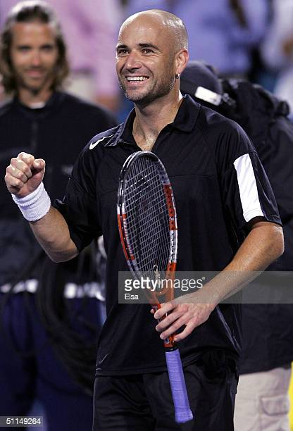Andre Agassi celebrates his win over Carlos Moya of Spain during the Western and Southern Financial Group Masters on August 6 2004 at the Lindner...