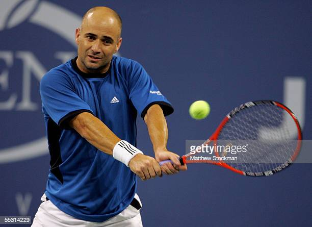 Andre Agassi eyes a backhand from James Blake during the quarterfinals of the US Open at the USTA National Tennis Center in Flushing Meadows Corona...