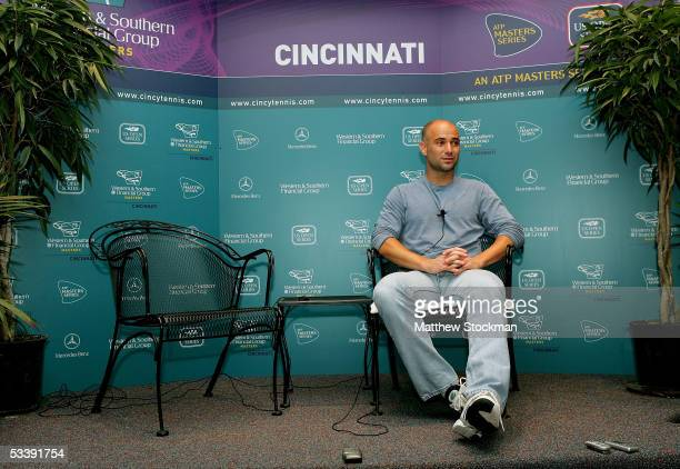 Andre Agassi fields questions from the media after announcing his withdrawal from the tournament at a press conference during the Western and...
