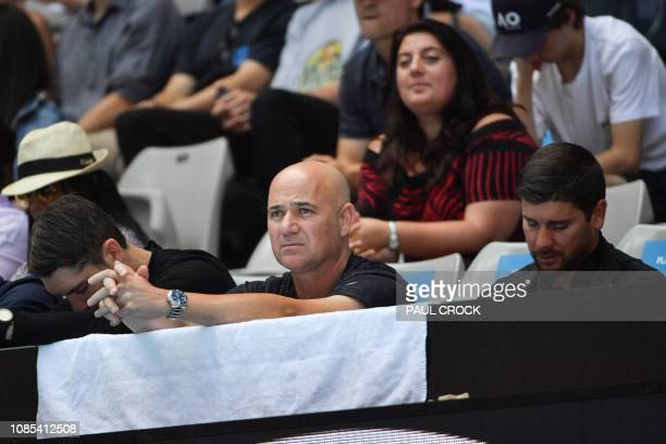 Andre Agassi former US tennis player and coach of Bulgaria's Grigor Dimitrov watches during his men's singles match against Frances Tiafoe of the US...
