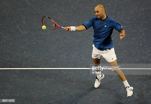 Andre Agassi hits a forehand in the front court to James Blake during the quarterfinals of the US Open at the USTA National Tennis Center in Flushing...