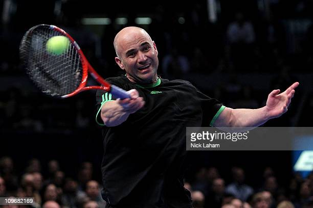 Andre Agassi hits a return against Pete Sampras during the BNP Paribas Showdown at Madison Square Garden on February 28 2011 in New York City