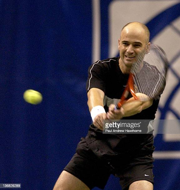Andre Agassi hits a return shot during his match with Mardy Fish at the 2004 Siebel Open in San Jose, California, February 14, 2004. Fish upset...
